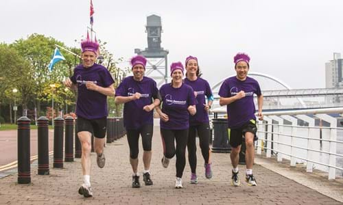 delegates participating in a run along Glasgow's clydeside