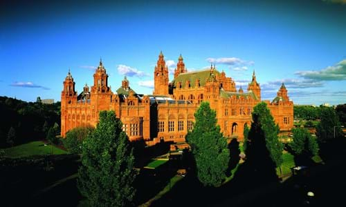 Exterior view of Kelvingrove Art Gallery & Museum surrounded by greenery situated within Kelvingrove Park
