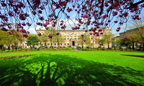 Blythswood Square Hotel exterior with lawns and cherry blossom
