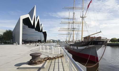 Exterior side view of the Riverside Museum and Tall Ship at the clydeside on a bright sunny day