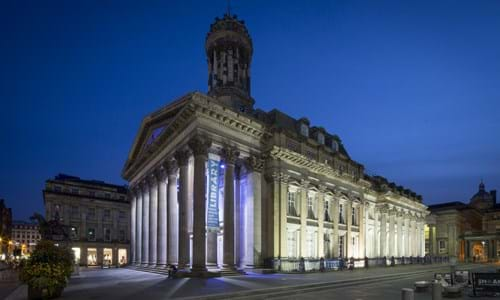 Exterior view of the Gallery of Modern Art within Royal Exchange Square in the evening