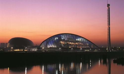 Sunset view accross the River Clyde of the Glasgow Science Centre, IMAX Theater and Glasgow Tower