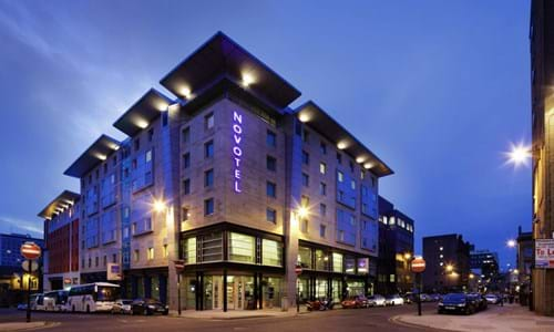 Exterior entrance of Novotel Glasgow in the evening